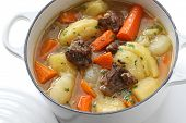 stock photo of stew pot  - irish stew in enamel pot - JPG