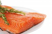 stock photo of fresh water fish  - fresh raw red fish fillet on white plate and rosemary - JPG