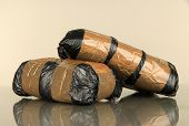 pic of smuggling  - Packages of  narcotics on gray background - JPG