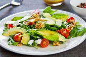 stock photo of walnut  - Avocado with Spinach Feta and Walnut salad - JPG