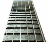 stock photo of fret  - clean style Fret board made out of rose wood - JPG