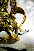 stock photo of venetian carnival  - Vintage venetian carnival mask with glittering background - JPG
