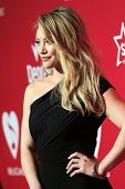 LOS ANGELES - JAN 24: Hilary Duff at the 2014 MusiCares Person Of The Year event at the Convention C