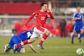 VIENNA,  AUSTRIA - MARCH 22 Philipp Hosiner (#20 Austria) runs with the ball during the world cup qu