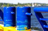 picture of bollard  - Bollards and fence on a small ferry with seascape in background - JPG