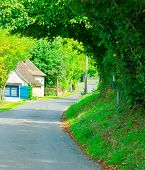 image of paved road  - Winding Paved Road in the French Village - JPG