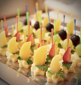 stock photo of fruit platter  - Canapes of cheese with fruits - JPG