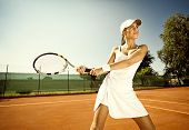 stock photo of sportswear  - Woman in sportswear plays tennis at training - JPG