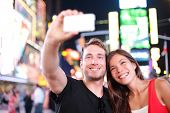 stock photo of couples  - Dating young couple happy in love taking selfie self - JPG