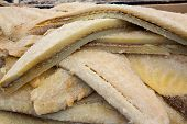 stock photo of hake  - Cod fish salted codfish in a row stacked in market - JPG
