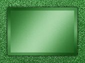 stock photo of bronze silver gold platinum  - Green colored metallic plate on a green metallic background - JPG
