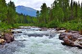 stock photo of siberia  - A river in Kuznetsk Alatau mountains Western Siberia Russia - JPG