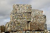 stock photo of scrap-iron  - Block of recycled aluminum and tin can at a metal scrap recycle yard - JPG