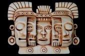 stock photo of cultural artifacts  - Mayan artifact of faces and masks symbolising rebirth on a black background - JPG