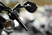 stock photo of levers  - Detail with the lever and turn signal of a motorcycle.