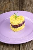 picture of chicory  - Heart shaped saffron rice with trevisano chicory served on a pink plate over a wooden background - JPG