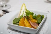 pic of endive  - An appetizer of sliced oranges and pork with arugula dill and endive - JPG