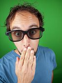 foto of shock awe  - Thirty year old man with 3d glasses watching a movie over a green background - JPG