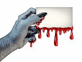 image of monsters  - Zombie monster hand holding a blank blood dripping card sign on a side view as a creepy halloween or scary symbol with textured white skin wrinkled monster fingers and stitches isolated on a white background - JPG