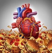 stock photo of clog  - Heart disease risk symbol and health care and nutrition concept as a human cardiovascular organ drowning in an ocean of greasy high salt unhealthy fast food as a symbol dangerouse artery clogging cholesterol crisis - JPG