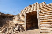 image of sauna  - Wooden wall and open door of old traditional underground sauna in Finland - JPG