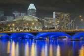 stock photo of singapore night  - bright cityscape of night Singapore with Esplanade drive bridge on foreground - JPG