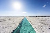 foto of salt mine  - Salt water pool on the Salinas Grandes salt flats in Jujuy province northern Argentina - JPG