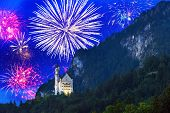 stock photo of firework display  - New Year fireworks display in Bavarian Alps - JPG
