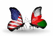 pic of oman  - Two butterflies with flags on wings as symbol of relations USA and Oman - JPG