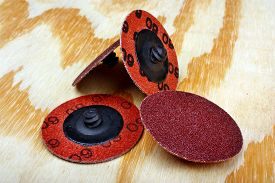 stock photo of abrasion  - Abrasive sanding discs for grinding and cleaning of wood paint metal and other material - JPG