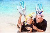 pic of flipper  - Joyful diver couple lying down on the beach - JPG