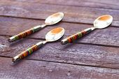 image of tablespoon  - background striped tablespoons on an old board - JPG