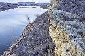 foto of horsetooth reservoir  - winter dusk over mountain lake with sandstone cliffs  - JPG