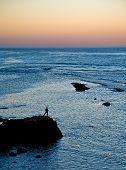 foto of asilah  - A person watching a beautiful sunset from Asillah - JPG