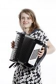 picture of accordion  - teenage girl stands in studio with accordion against white background  - JPG