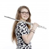 picture of flute  - blond teenage girl with glasses holds flute in studio against white background - JPG
