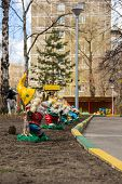 stock photo of gnome  - colorful garden gnomes figures in the courtyard of the kindergarten - JPG