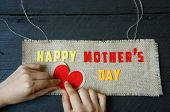 stock photo of happy day  - Happy mothers day with i love mom message idea from colorful letter on wooden background woman hand cutting character to make gift for mother on happy day show feeling with mother love family - JPG