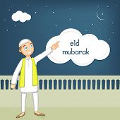 foto of eid mubarak  - Cute Muslim boy in traditional dress pointing towards the moon on occasion of Islamic festival - JPG