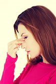 picture of sinuses  - Young woman with sinuses pain - JPG