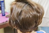 foto of scalping  - Closeup detail of a woman at hairdresser showing hair style - JPG