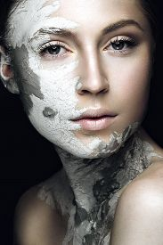 stock photo of face mask  - Beautiful girl with mud on his face - JPG