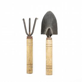 picture of spade  - old gardening tools spade and rake isolated on white background - JPG