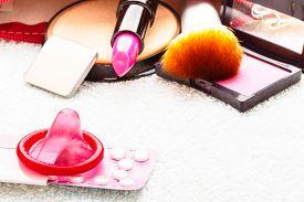 foto of contraceptives  - Healthcare medicine contraception and birth control. Closeup oral contraceptive pills condom and cosmetics. ** Note: Shallow depth of field - JPG