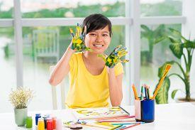 foto of schoolgirl  - Asian schoolgirl showing her painted palms indoors - JPG