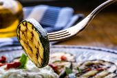 Постер, плакат: Zucchini Slices of grilled zucchini on a plate Vegetarian Mediterranean cuisi
