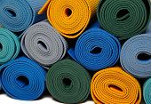 pic of yoga mat  - many colorfull yoga mats as a background - JPG