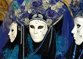 foto of carnivale  - a woman with beautiful eyes looks out from behind a mask at carnivale in veniceitaly - JPG