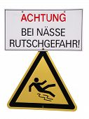 image of slip hazard  - Danger sign with white background which warns that there is slip hazard if it is wet - JPG