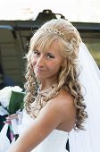 foto of low-necked  - Portrait of a young beautiful bride with blonde curly hair in a white low - JPG
